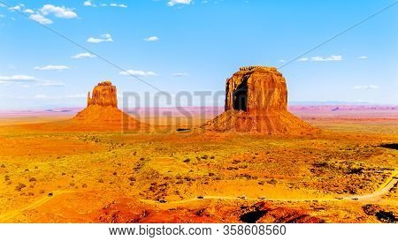 The Sandstone Formations Of West Mitten Butte And Merrick Butte In The Desert Landscape Of Monument