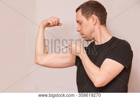 Man Inject Steroid Hormone. Copy Space. Biceps Bodybuilder Muscle Doping. Growth Injection Procedure