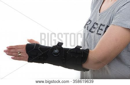 Woman With Left Hand Orthosis Isolated Onw Hite Background