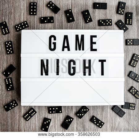 Game Night Text Frame Of Dominoes With Copy Space Inside On Wooden Background, Table Game, Black Dom
