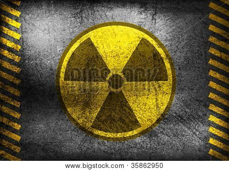 Nuclear radiation symbol on grunge wall. Vector background