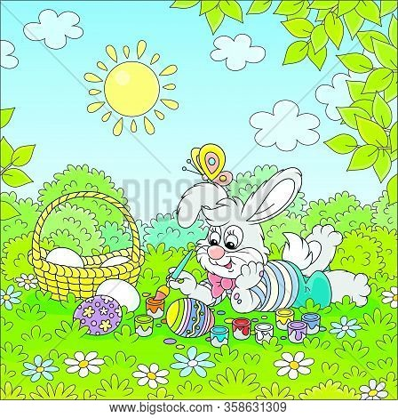 Happy Little Bunny Painting And Decorating Easter Eggs With Bright And Colorful Paints And A Paintbr