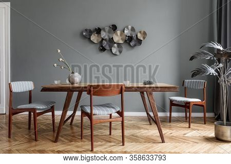 Glamour And Stylish Dining Room Interior With Wooden Table, Elegant Chairs And Design Decorations. T