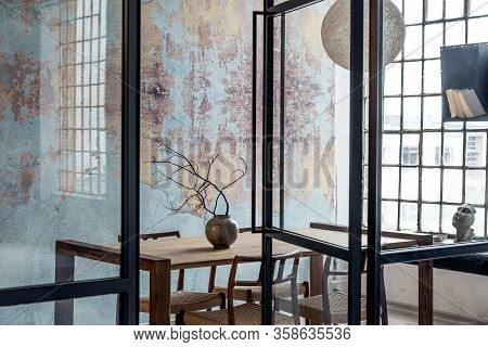 Stylish Interior Design Of Dining Room In Loft Apartment With Wooden Sharing Table, Chairs, Branch I