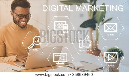 Digital Marketing Concept. Set Of Internet Commerce Icons On Virtual Screen And Happy Businessman Wo