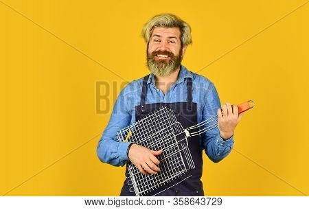 Tools For Roasting Meat. Man In Apron Hold Barbecue Grill. Chef Cooking Bbq Food. Culinary Concept.