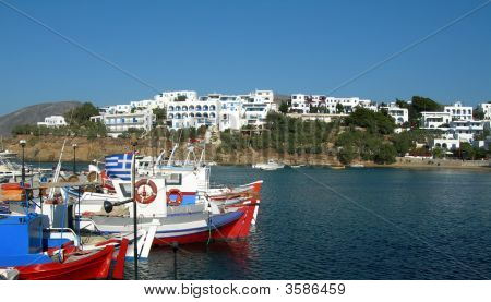 Greek Fishing Boats In Piso Livadi Harbor With Cyclades Architecture