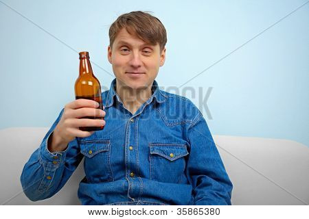 Man Relaxing With A Bottle Of Beer