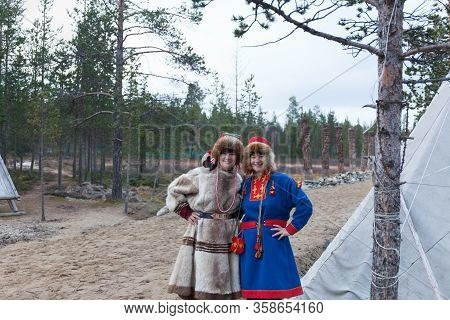 Two Female Saami, Sami In National Dress, Saami Village On The Kola Peninsula, Russia