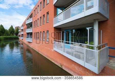 Balconies Of A Retirement Home Next To A Pond