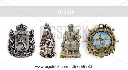 Souvenirs (magnets) From Russia Isolated On White Background. Russian Inscription Does The City Name