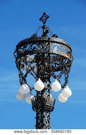 Ornate Wrought Iron Streetlight In The Plaza De San Fernando, Carmona, Seville Province, Andalucia,