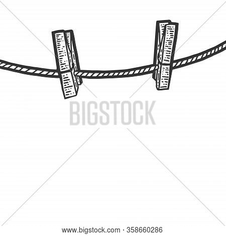 Clothesline And Two Wooden Clothespins. Engraving Vector Illustration
