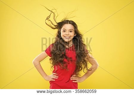 Girl Adorable Kid Long Wavy Hair Yellow Background. Strong Persistent Winds Can Create Tangles And S