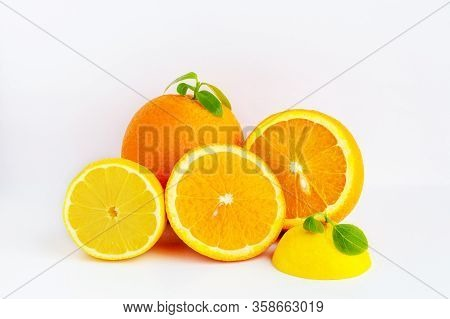 Juicy orange on a white background.Orange fruit with orange slices and leaves isolated on a white ba