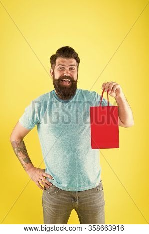 Gender Differences In Purchase Decision Making. Happy Hipster Hold Paper Bag. Bearded Man Smiling Wi