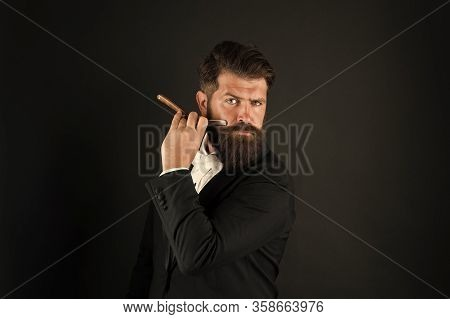 Barbershop For Gentlemen Only. Businessman Hold Barbers Tool Dark Background. Bearded Man Shave In B