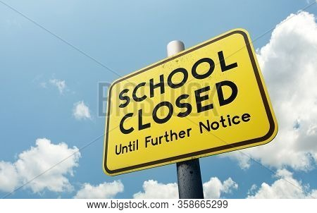 A School Closed Until Further Notice Public Road Sign. Schools Closing Globally Due To Covid-19 Coro