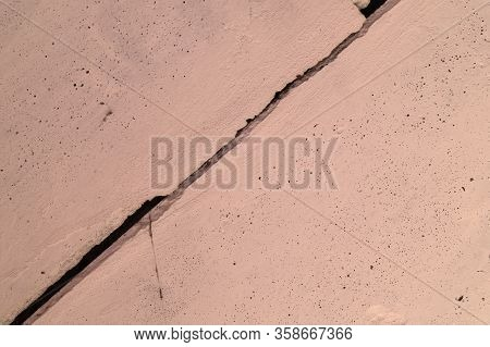 The Pink Concrete Wall. The Wall Is Textured.