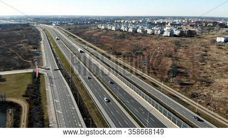 From Above Of Modern Multi Lane Roadway With Car Traffic In Contemporary Megalopolis In Sunny Autumn