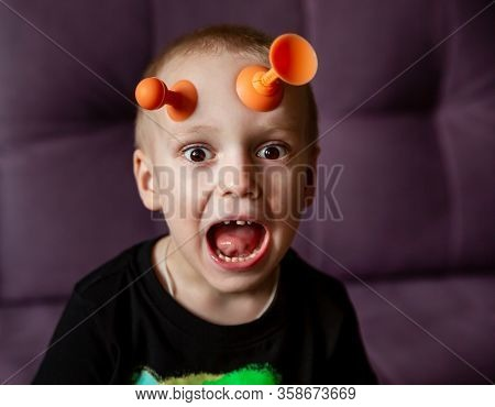 Funny Child With Antennas On His Forehead
