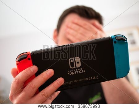 Uk, March 2020: Nintendo Switch Games Console Player Losing Disappointed With Head In Hands