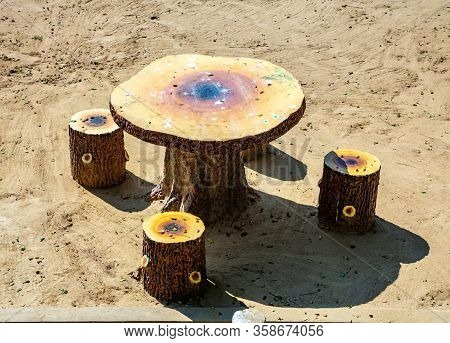 Unnatural Table And Chairs In The Form Of Stumps Are Made Allegedly Under A Tree With Patterns.for T