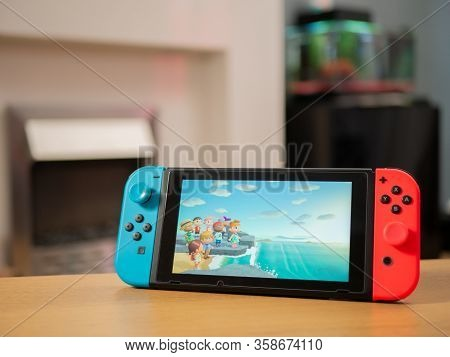 Uk, March 2020: Nintendo Switch Games Console Animal Crossing New Horizons Characters On Beach