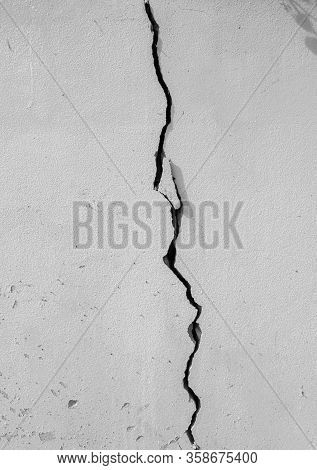 Close Up Of White Concrete Wall With Cracked Broken, Vertical Image