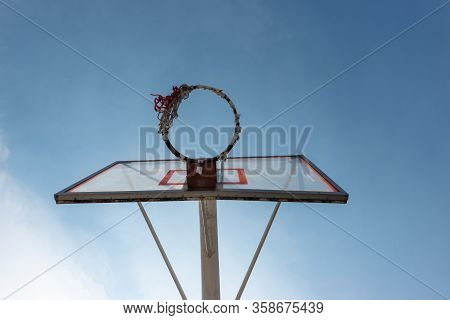 Close Upo Of Old Basketball Hoop In The Sky