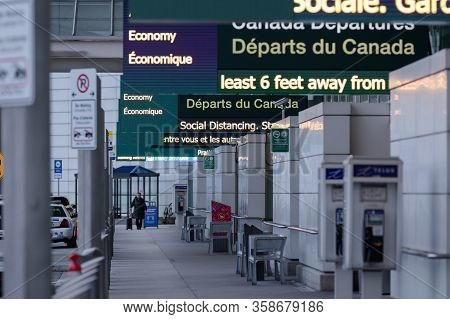 Richmond, Bc, Canada - Mar 29, 2020: Travellers In The International Departures Section Of Yvr Which