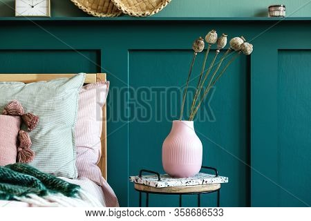 Stylish Composition Of Bedroom Interior With Wooden Bed, Design Furnitures, Shelf, Dried Flowers In
