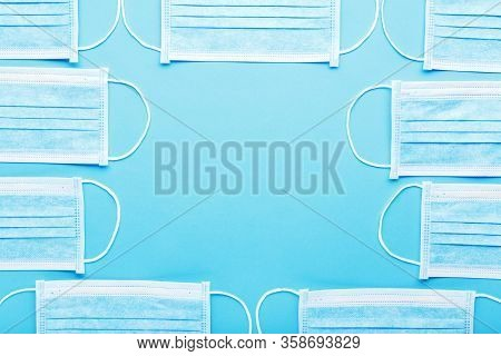 Medical Hygienic Masks, Medical Protective Masks Blue Background With Copy Space. Disposable Surgica