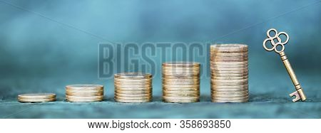Money Savings, Gold Coins And Key On Blue Background. Coronavirus Financial Stimulus, Aid Package, H