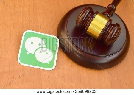 Wechat Paper Logo Lies With Wooden Judge Gavel. Entertainment Lawsuit Concept