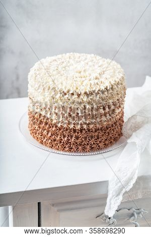 Beautiful Buttercream Ombre Cake On Vintage White Table Behind Light Wall Background. Copy Space. Ce