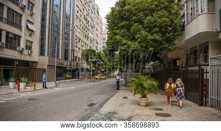 Rio De Janeiro, Brasil-  February 27, 2020: Rua Xavier Da Silveira. Moving Transport And Citizen
