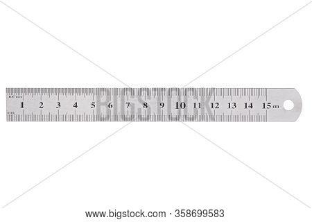 A Metal Ruler With A Scale Of Up To 15 Centimeters Is Isolated On A White Background.