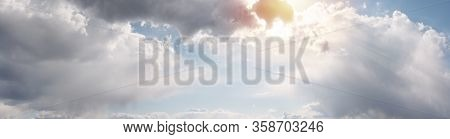 Beautiful Cloudscape With Warm Sunny Tonings. Blue Sky Covered With Clouds. Warm Sunlight And Sun Ra