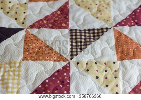 A Patchwork Quilt Or Bedspread.a Fragment Of A Patchwork Quilt As A Background. Colored Patchwork Qu