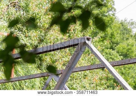 Railing Of The Bridge Over The River. Iron Railing. Nature/