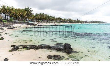 Beautyfull Mauritius Beach. Sand Rocks Palms Blue Water