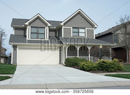 Gray Wood Sided House with Arched Porch