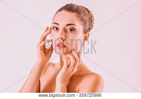 Sensual Attractive Girl Beauty Fashion Model Touching Her Perfect Smooth Face With Hands. Young Beau