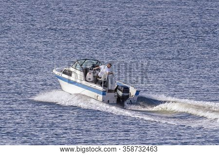 Fairhaven, Massachusetts, Usa - April 25, 2019: Boater Evaluating The Operation Of His Outboard Moto