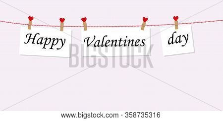 Happy Valentine's Day Concept With Text On Paper Hanging On A Rope Attached With A Clothespin. To Th