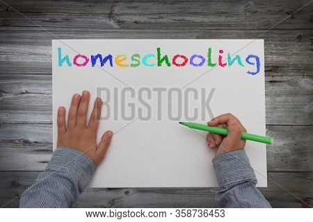 Kid With Pen And Paper Homeschooling Concept