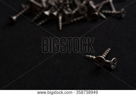 A Lot Of Black Screws. Construction Materials. Consumables For Construction And Housework. Screws Fo