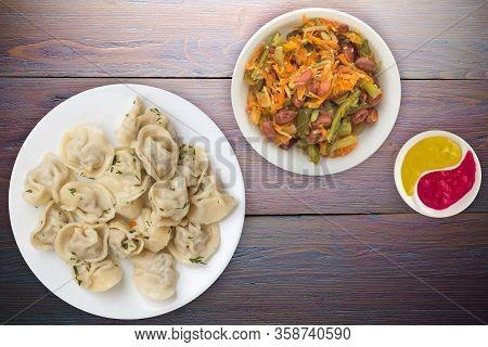 Dumplings On A White Plate On Purple Wooden Background .boiled Dumplings With Salad.meat Dumplings T