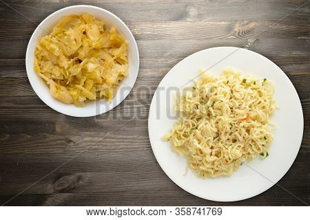 Vermicelli On A White Plate On Black Wooden Background. Vermicelli On A Plate With Vegetarion Salad